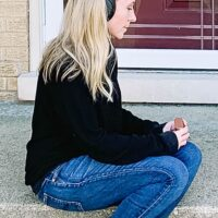 Me sitting on porch listening to music.