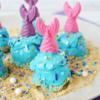 Donuts decorated for an under the sea party with mermaid fins.