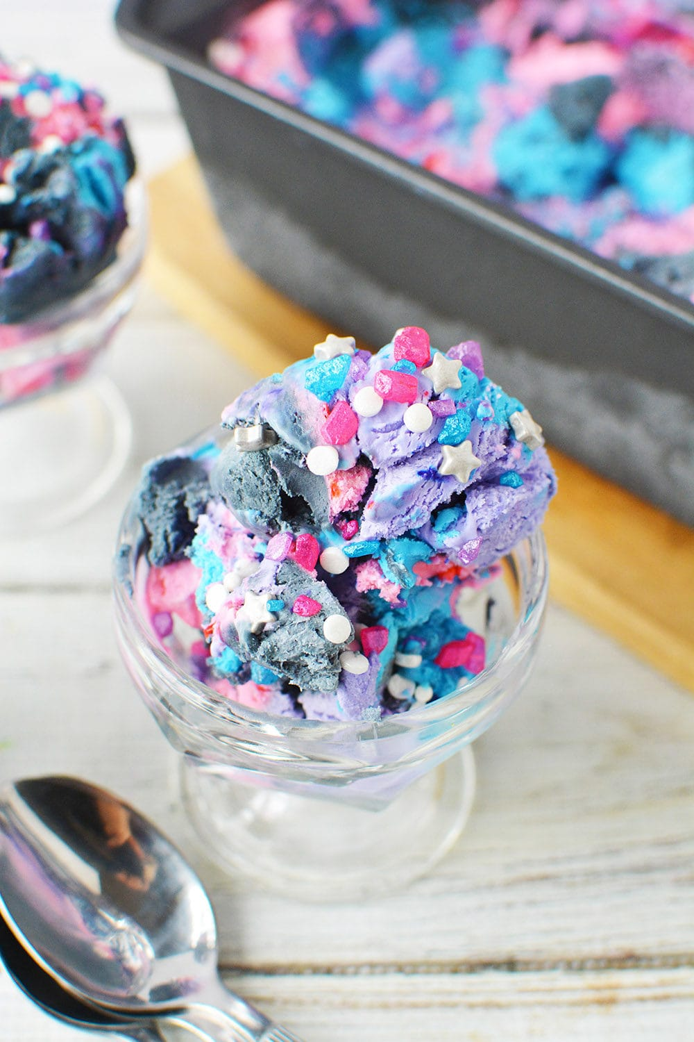 Scoop of galaxy ice cream in a sundae dish.