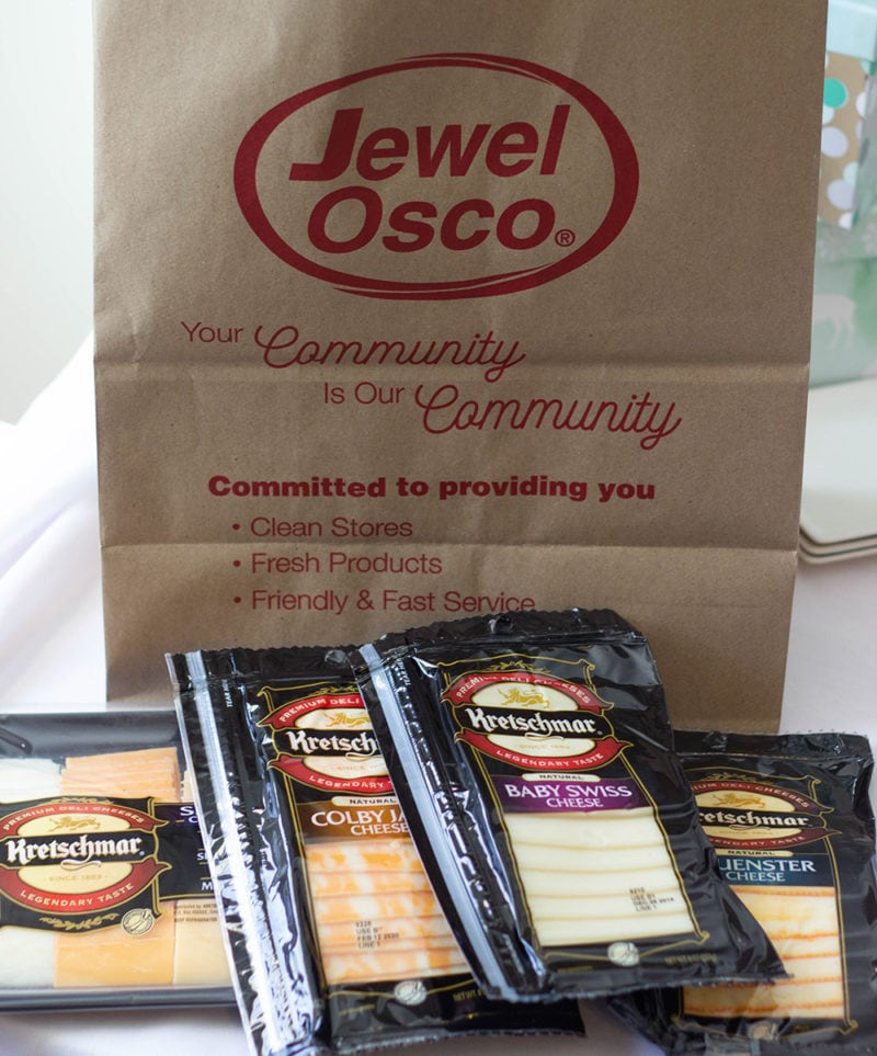 Cheese packages in front of Jewel bag