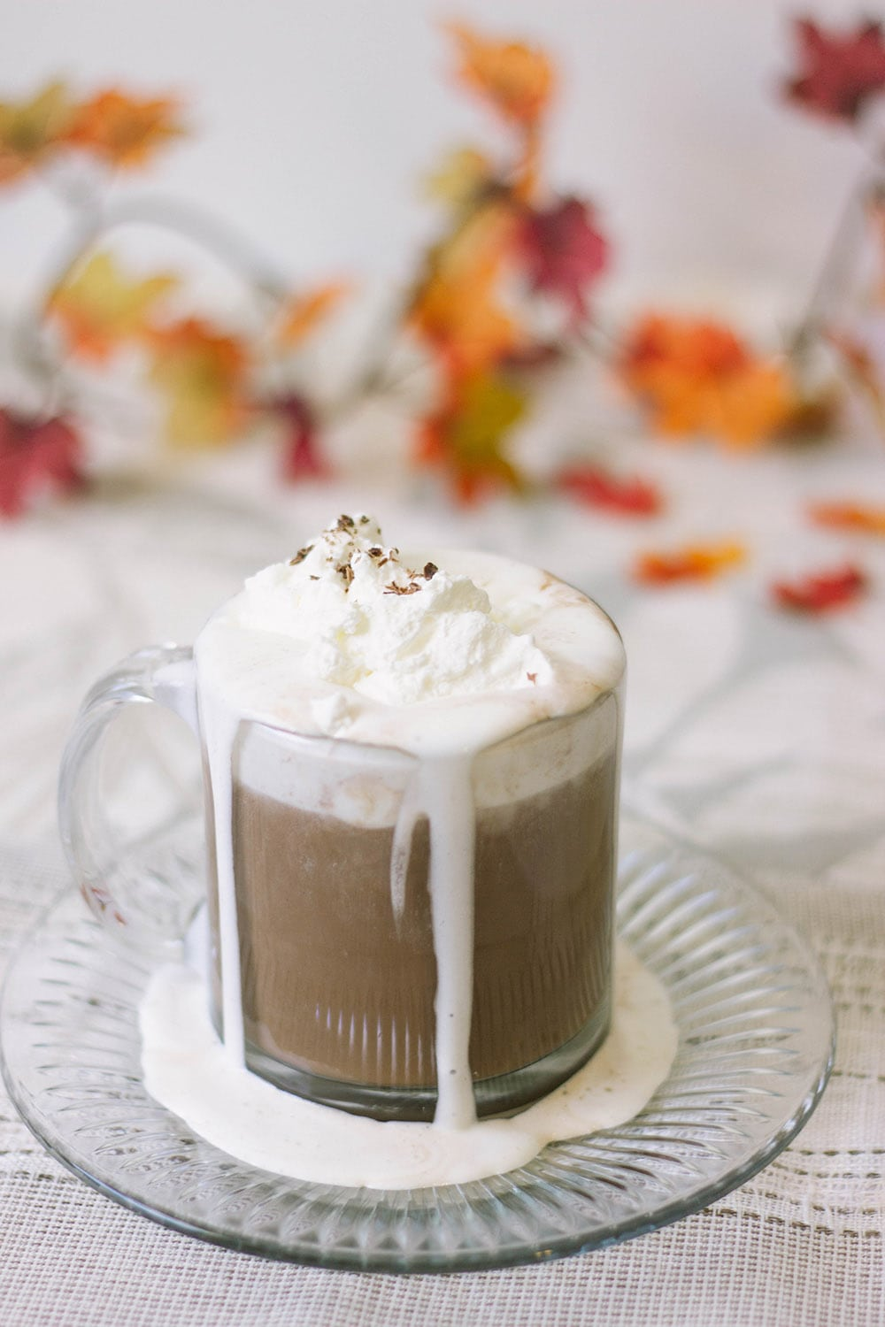 Glass of low carb hot chocolate with keto whipped cream