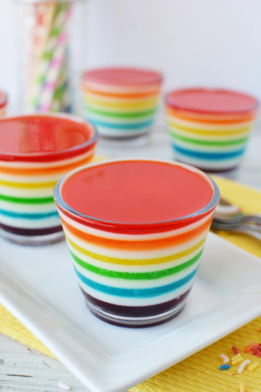 Rainbow Jell-o cups on a table