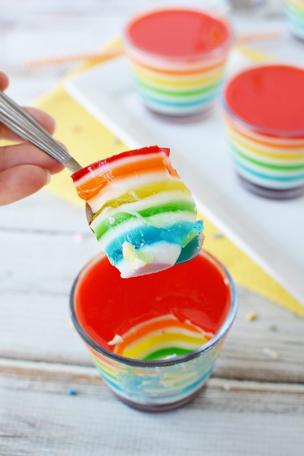 Spoonful of rainbow layered Jell-o