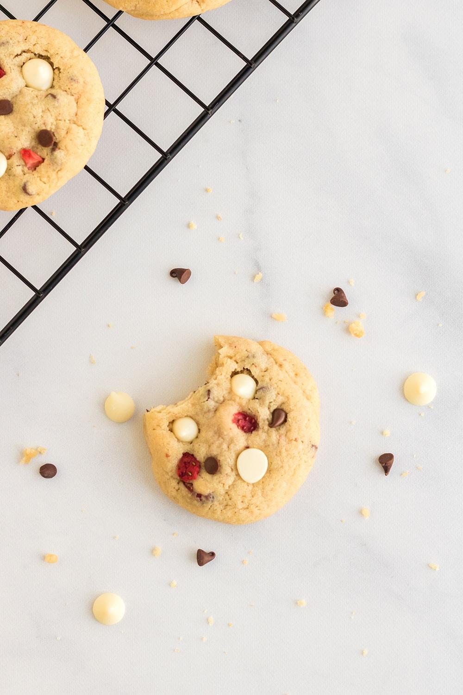 Overhead shot of bitten cheesecake cookie