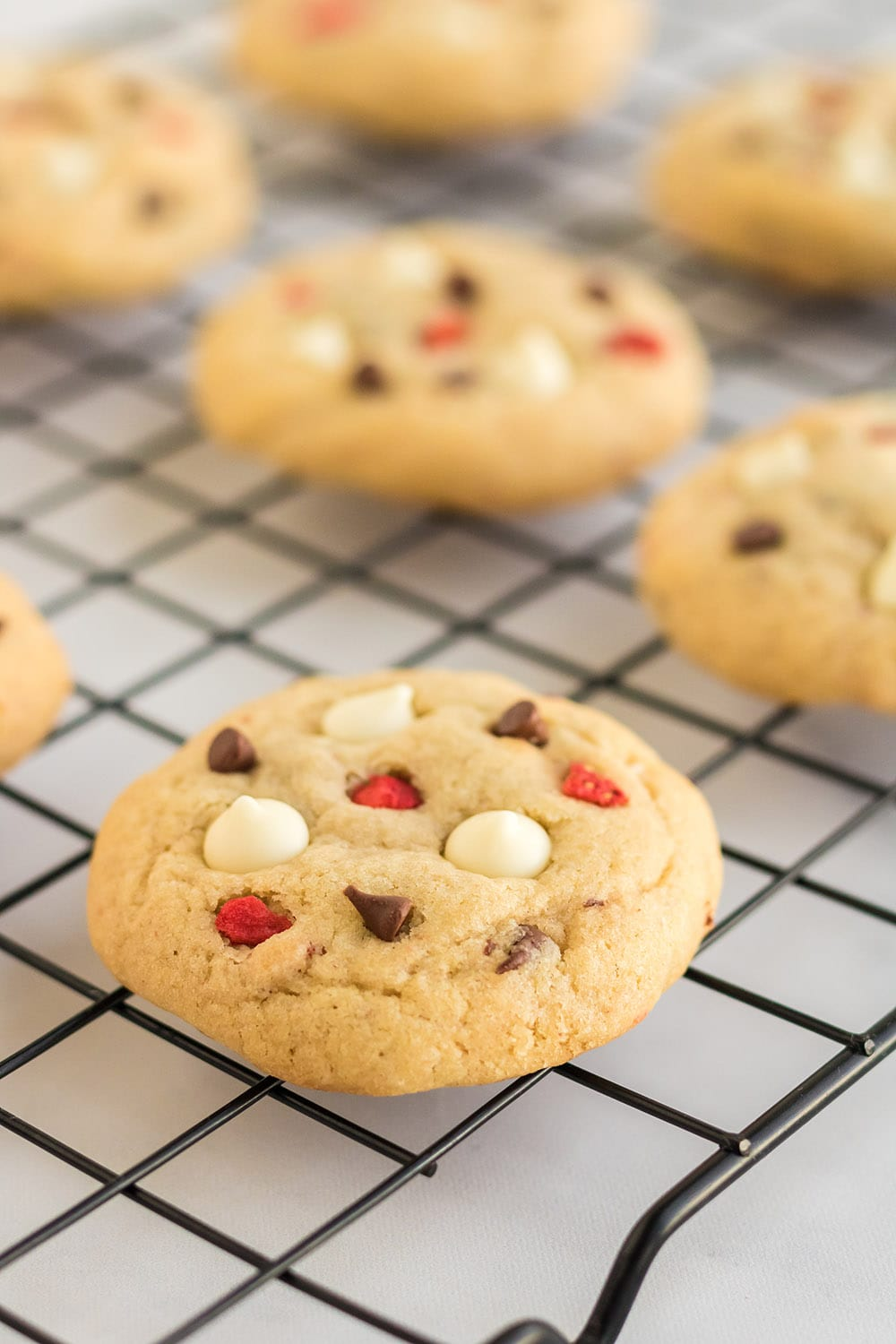 Strawberry cheesecake cookies on rack