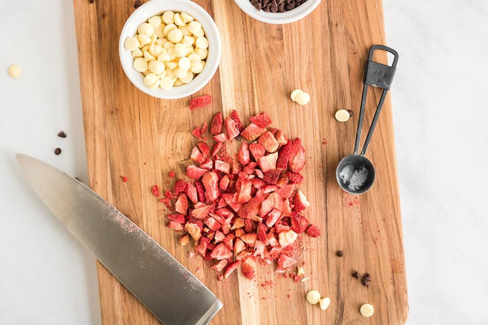 Chopped strawberries on cutting board