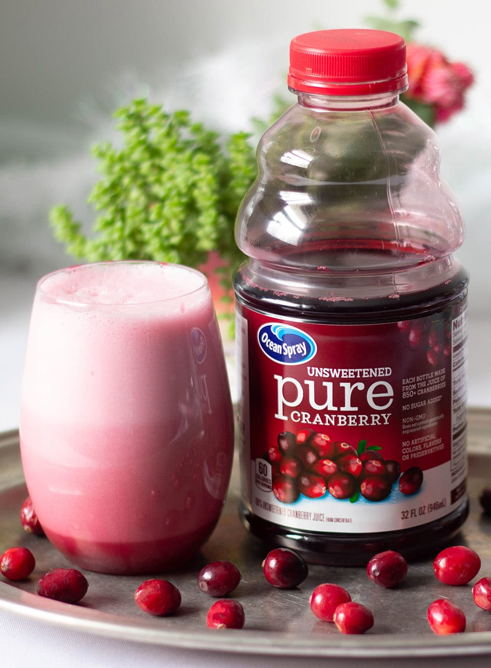 Cranberry slushy drink next to bottle