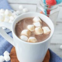 Mug of hot cocoa topped with marshmallows on a table