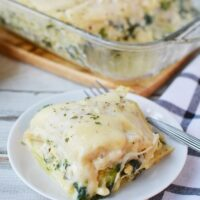 Chicken lasagna with spinach topped with cheese