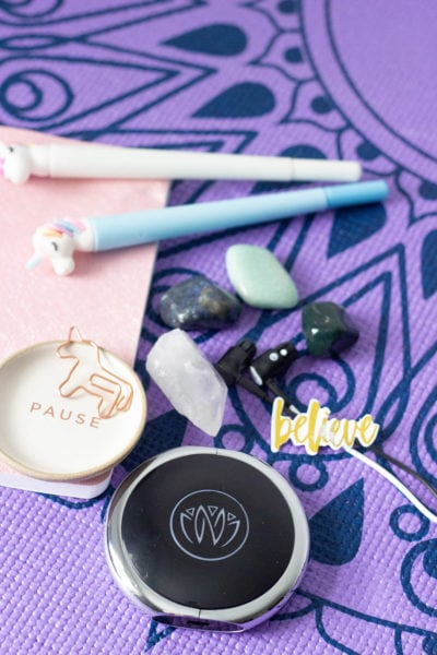 Unicorn pens, stones, and Zen unit on a yoga mat