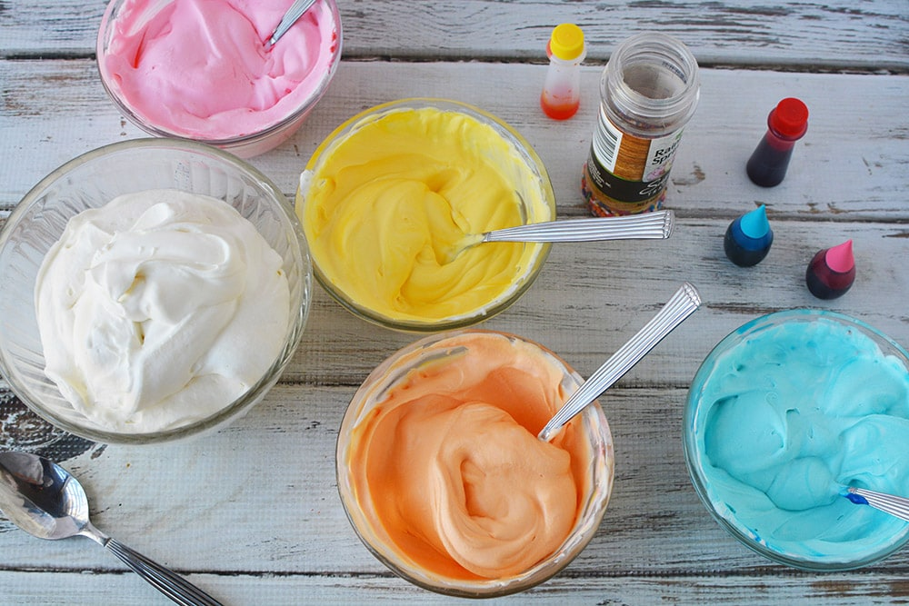 Colored bowls of ice cream mixture