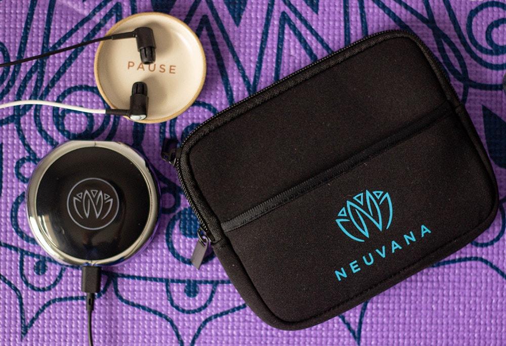 Neuvana ear buds on a yoga mat