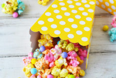 Rainbow popcorn mix in a yellow boxes