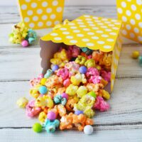 Rainbow unicorn popcorn in yellow popcorn boxes