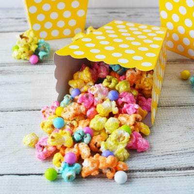 Rainbow unicorn popcorn in yellow popcorn boxes