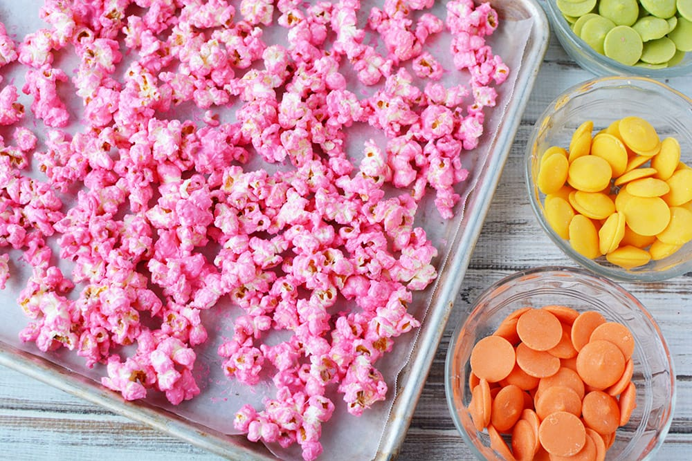 Pink popcorn on a baking sheet