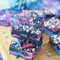 Stacked galaxy fudge with slices on a board