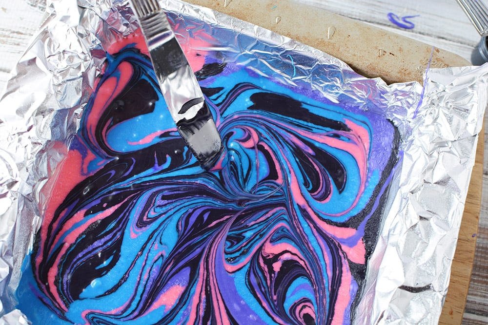 Swirling galaxy fudge with a knife