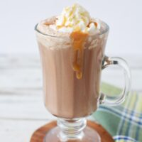 Salted caramel mocha in a glass with caramel dripping down sides