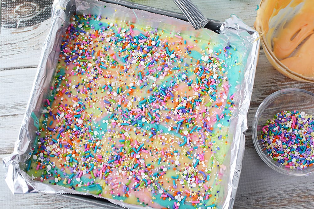 sprinkles on top of fudge in a pan