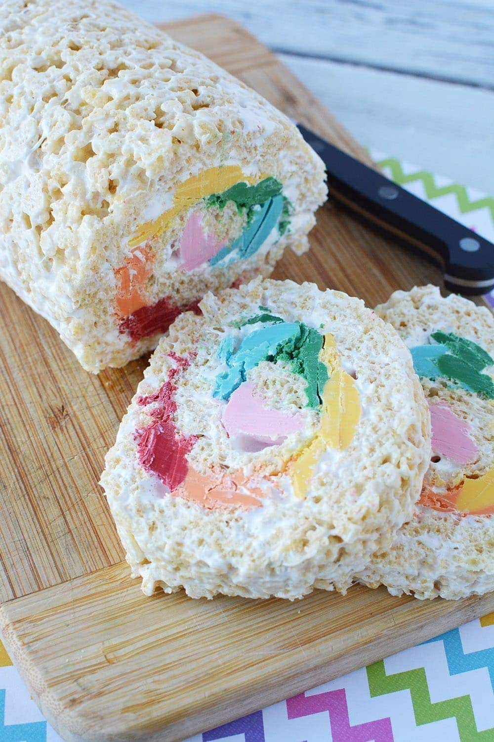 Pinwheel rainbow Rice Krispies treat on a board