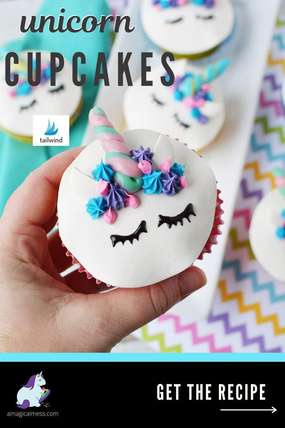 holding a cupcake with a unicorn face