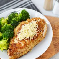 Herb crusted chicken and broccoli dinner on a plate