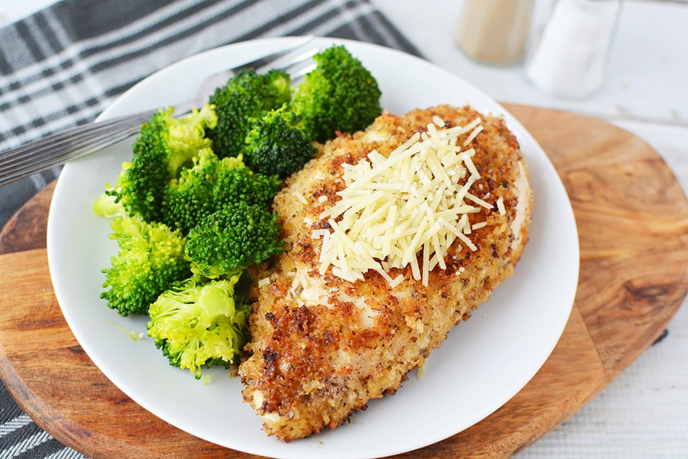 Parmesan crusted chicken on a plate with broccoli
