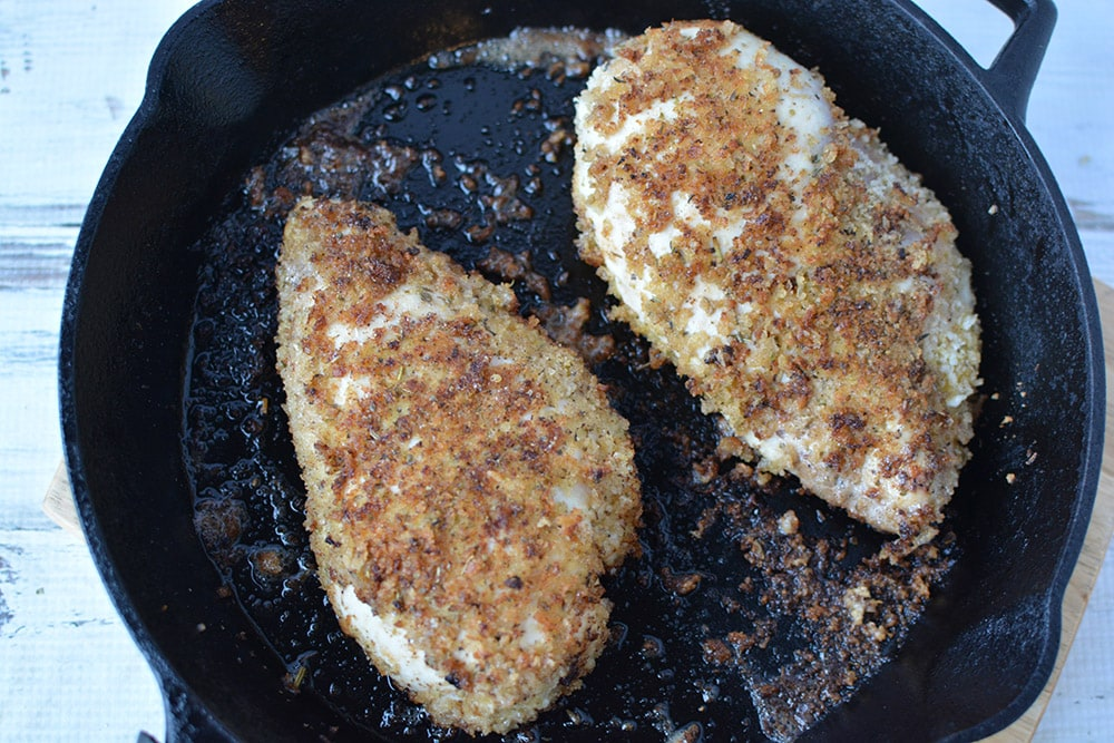 browned chicken breasts in pan