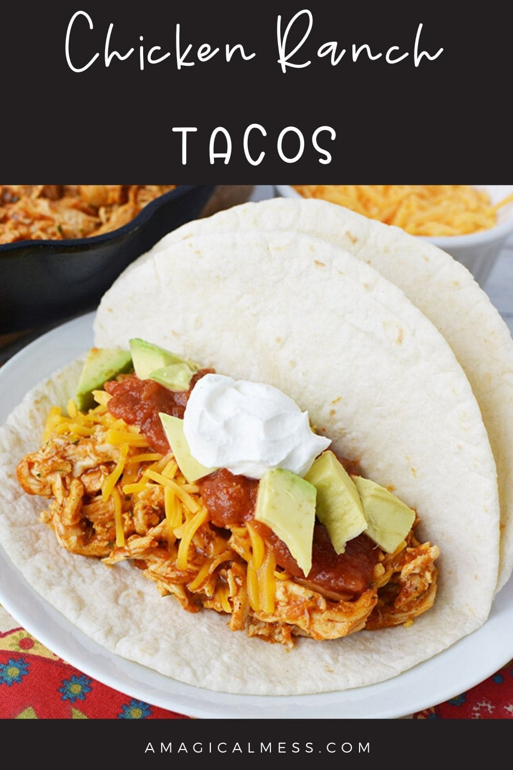 Shredded chicken taco with toppings on a plate