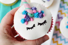 holding a cute unicorn face cupcake
