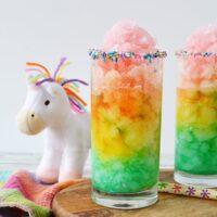 Unicorn slush in rainbow layers in glass