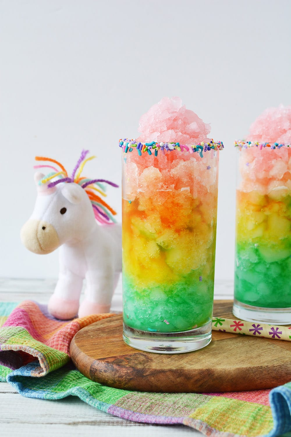 Unicorn slush in rainbow layers in glass