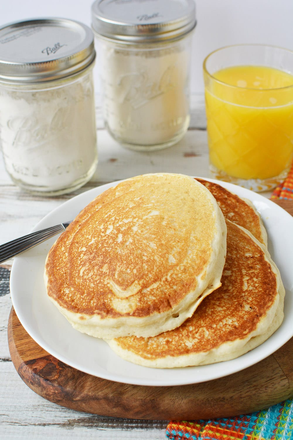 pancakes on a plate with mix in the background