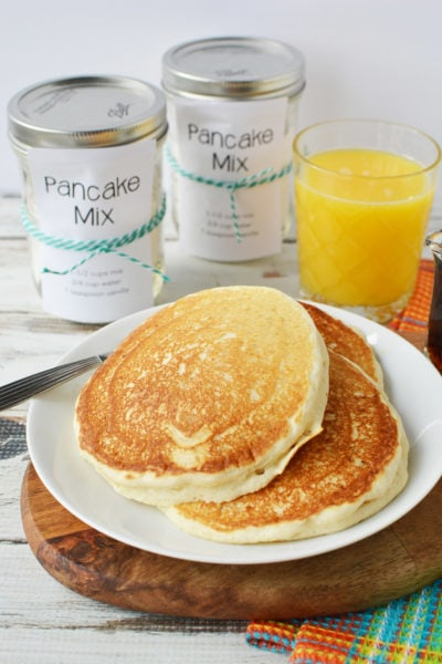 pancakes on a plate and jars and orange juice