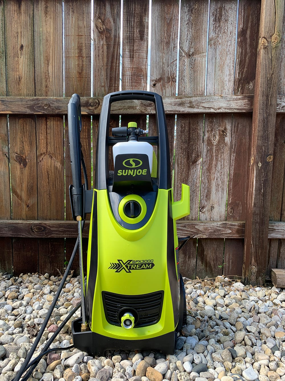 power washer in front of fence