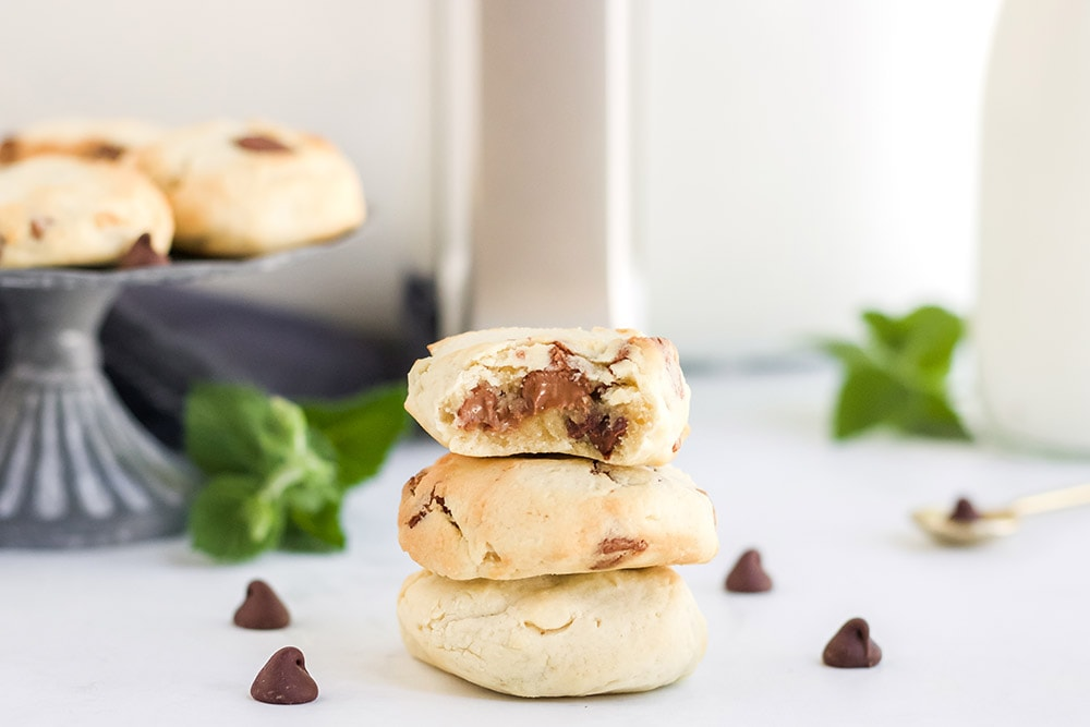 cookies stacked in front of air fryer