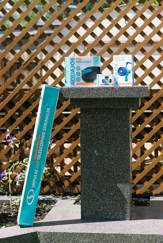 Aqua joe products on a terrazzo yard sculpture