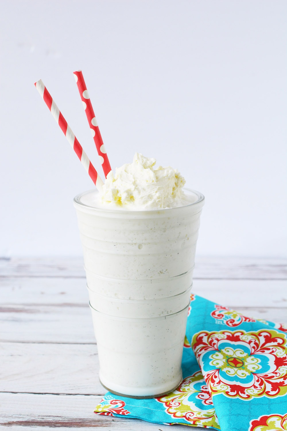Vanilla bean frappuccino topped with whipped cream in a glass