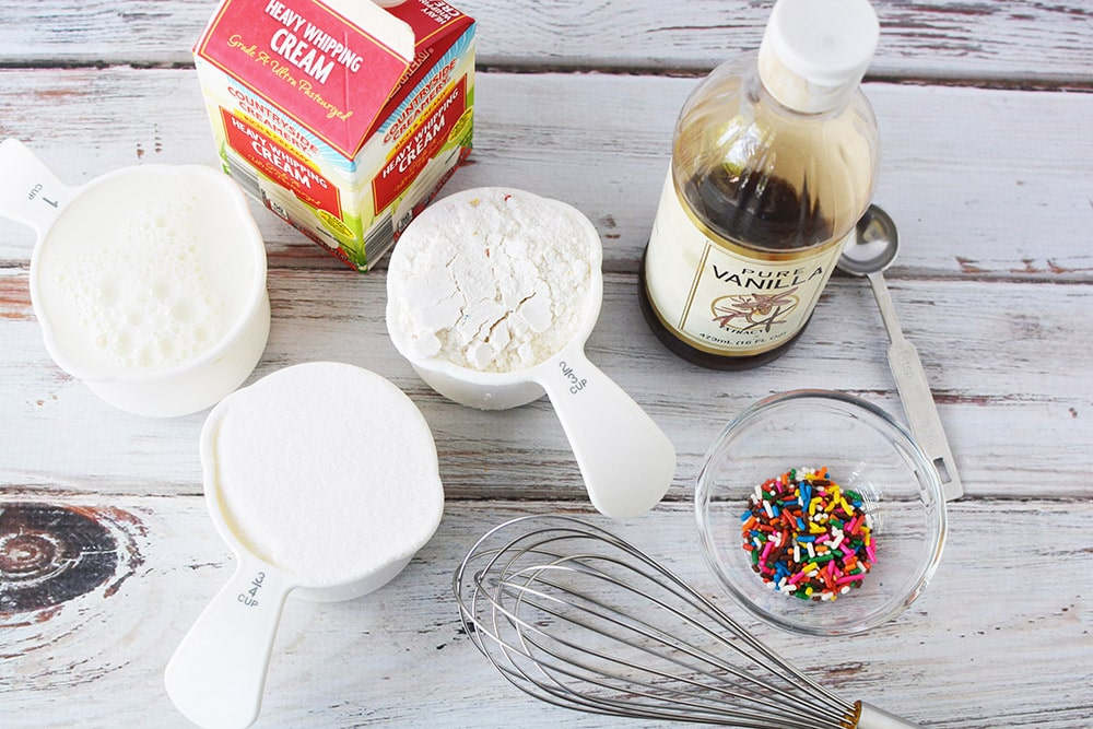 Ingredients to make birthday ice cream on a table