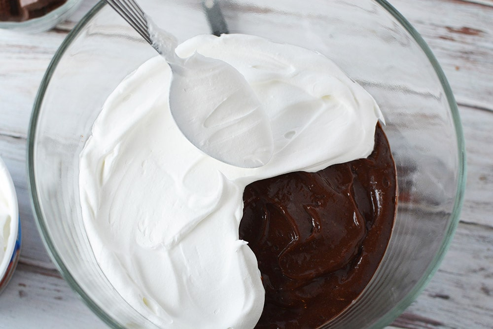 whipped cream on top of chocolate cake