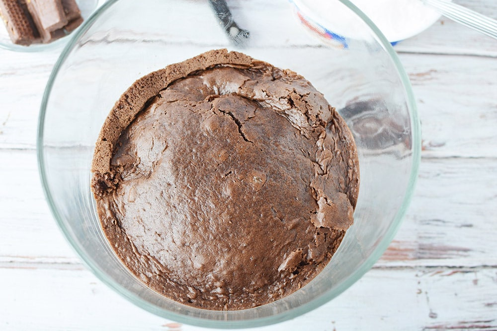 chocolate cake in the bottom of a trifle bowl