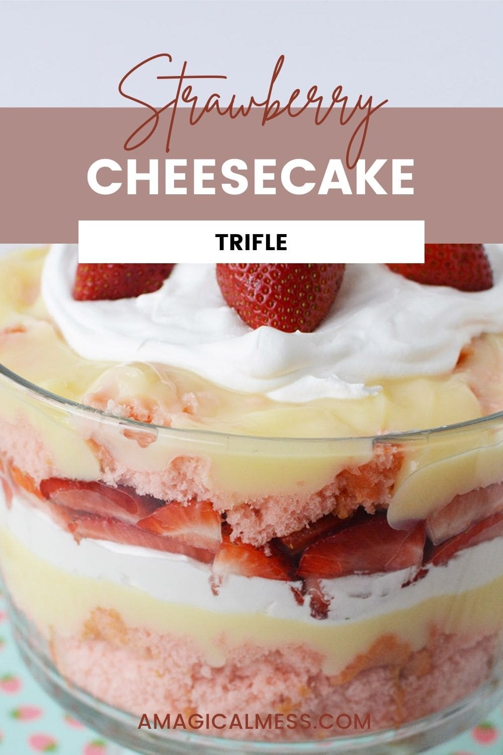 a trifle bowl filled with cake, strawberries, pudding, and whipped cream