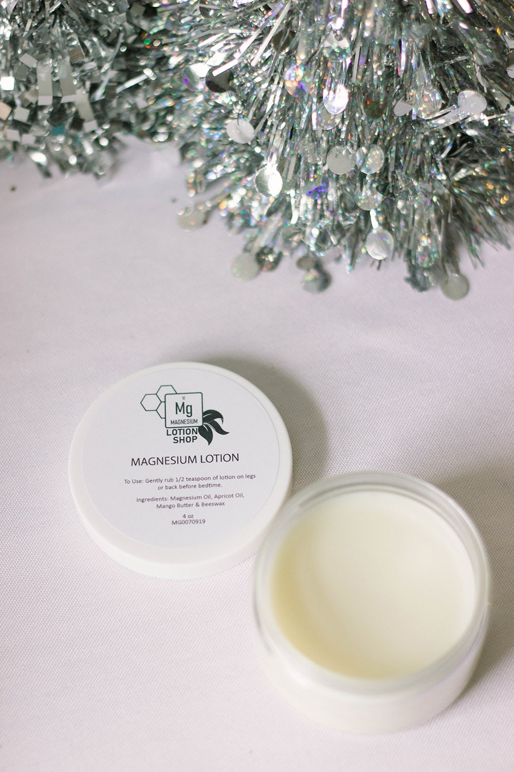 magnesium lotion in a little tub by a silver tree