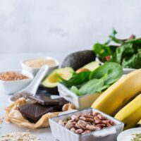 nuts, bananas, and other foods high in magnesium on a table