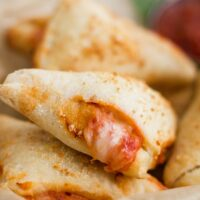 pizza roll with some cheese and sauce oozing out