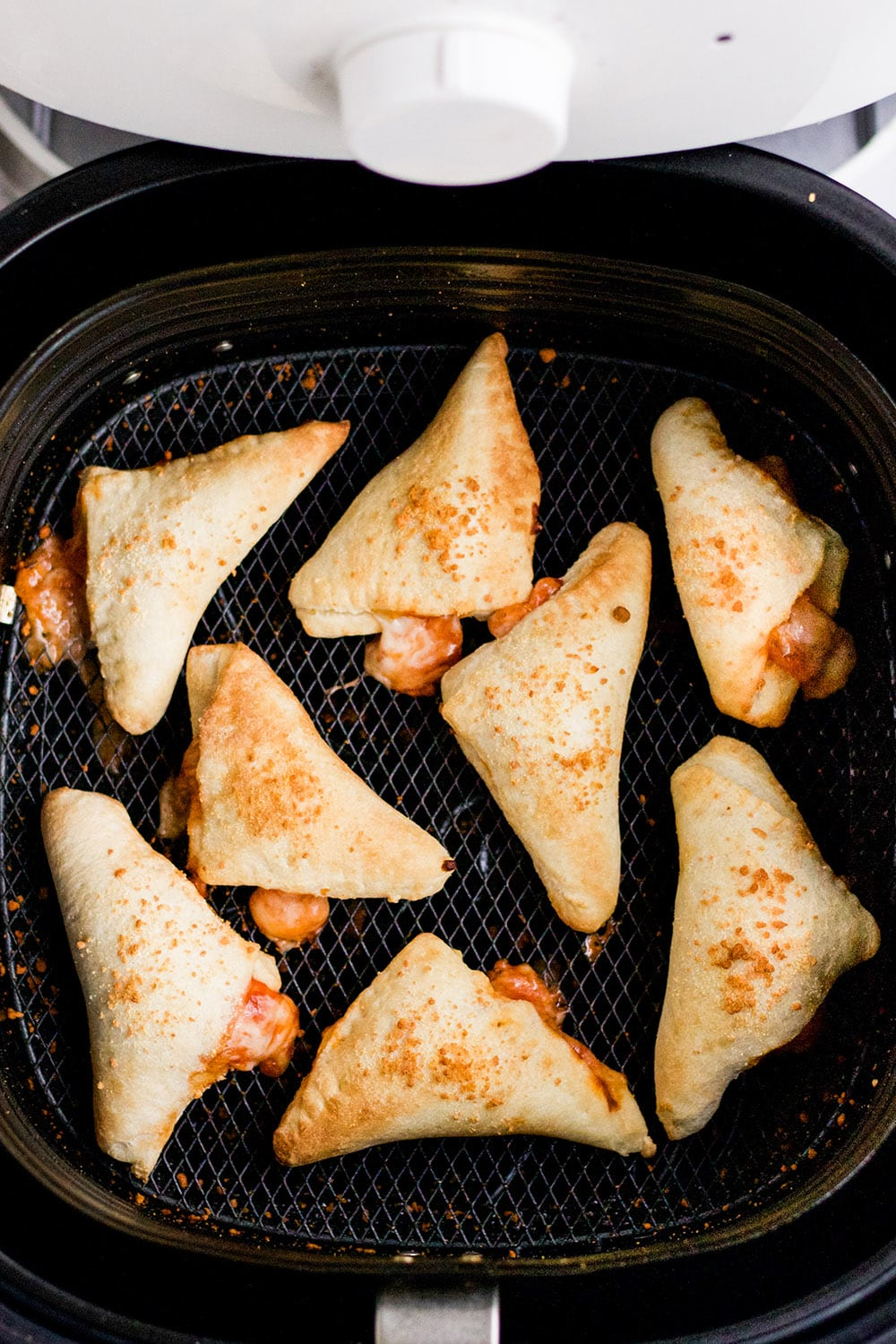 cooked pizza rolls in an air fryer