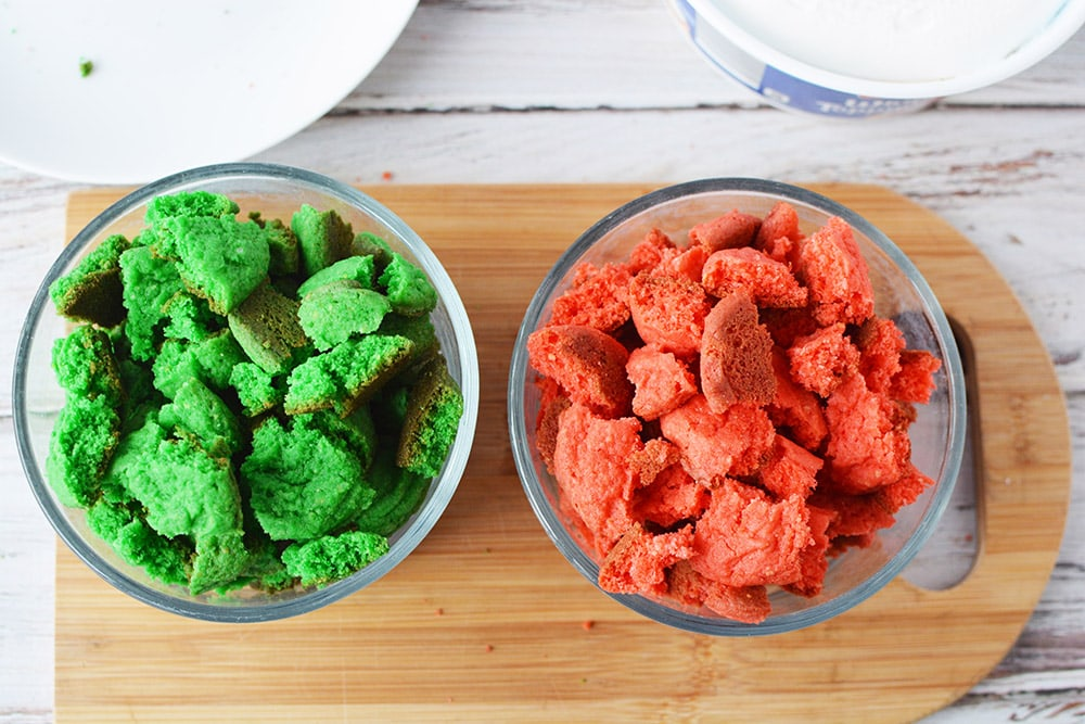 Red and green cookies broken up into bowls.