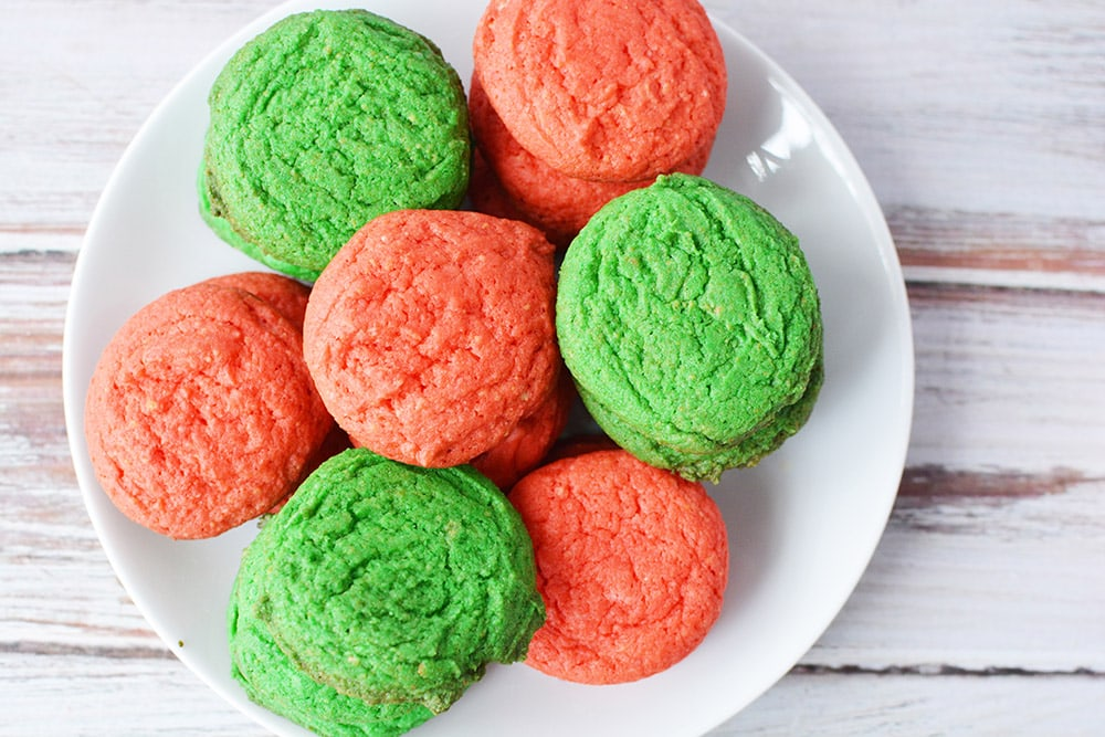 Red and green sugar cookies on a plate.