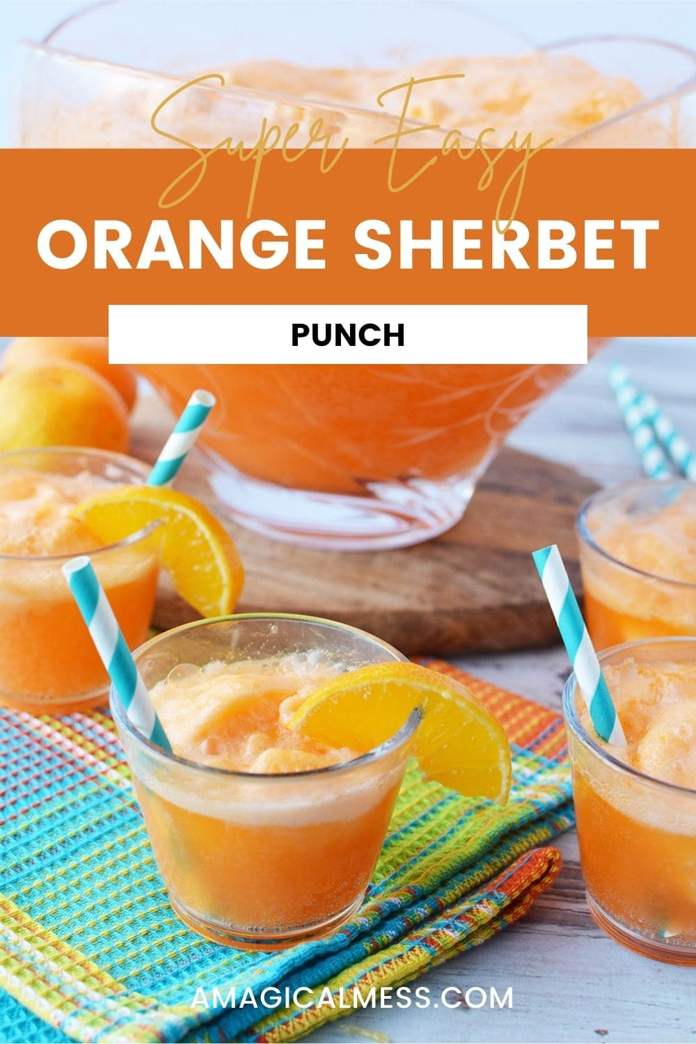 Glasses of orange sherbet punch in front of punch bowl.
